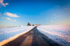Country road and snow covered farm fields in rural York County, Royalty Free Stock Image
