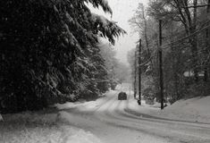 Country Road in Snowstorm. Treacherous driving along a country road in snowstorm stock photography