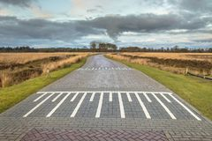 Country road with speed bump. In Fiesland, Netherlands stock photos