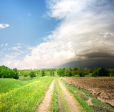 Country road and storm clouds Royalty Free Stock Image