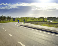 Country road on a sunny morning. Country road on the summer sunny morning Royalty Free Stock Image