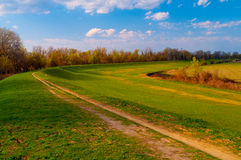 Country road on sunny spring day Stock Photography