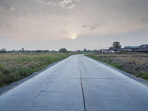 Country road and sunrise Stock Photography