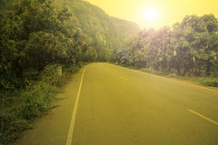 Country road and sunrise Royalty Free Stock Images