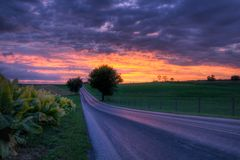 Country Road Sunset. Beautiful sunset on a lonely country road in Berks County Pennsylvania stock image