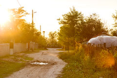 Country road in the sunset Stock Images