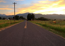 Country road sunset. Stock Photos