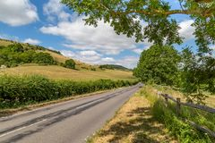 A Road in Sussex. A country road in Sussex surrounded by green fields, taken on a sunny summer`s day royalty free stock image