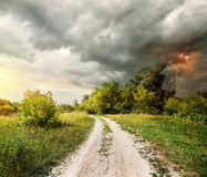 Country road and thunderstorm Royalty Free Stock Images
