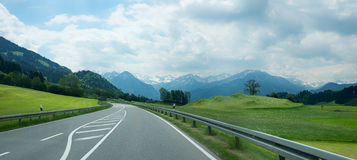 Country road to the allgau alps Royalty Free Stock Photos