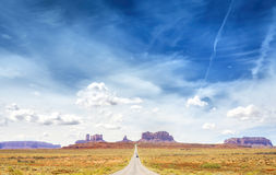 Country road to the Monument Valley. Stock Photography