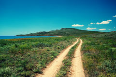Country road to the sea. And the mountain Royalty Free Stock Images