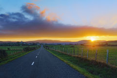 Country road to Unza at sunset Stock Photos