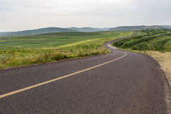 Country road. Travelling through a Field Royalty Free Stock Images