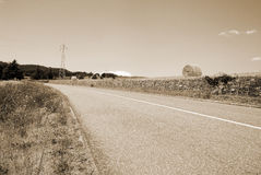 Country road turn left Royalty Free Stock Photography