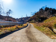 Country road. Under the blue sky stock photography