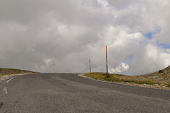 Country road under a cloudy sky in Apennines landscapes Royalty Free Stock Image