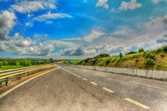 Country road under a scenic sky in hdr Stock Photo