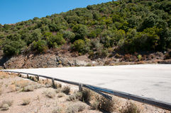 Country road. Unpaved mountain road through macchia vegetation, Corsica, Eurpoe stock image