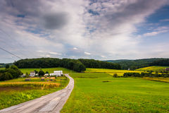 Country road and view of rolling hills in York County, Pennsylva Royalty Free Stock Photos