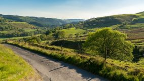 Country road in Wales. Single lane country road, near Cwmystwyth, Ceredigion, Dyfed, Wales, UK Royalty Free Stock Images