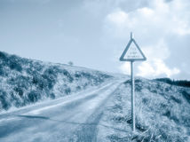 Country road with warning sign Stock Image