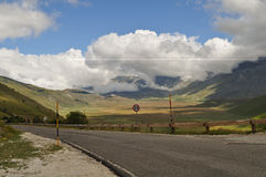 Country road with white clouds in Apennines landscapes Royalty Free Stock Images