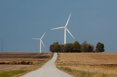Country road and a wind farm Royalty Free Stock Photography