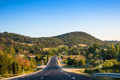 Country road winding through the French Provence. Near Bordeaux Stock Image