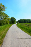 Country Road. Winding country road through green fields and forests in the German countryside in Spring Royalty Free Stock Photography