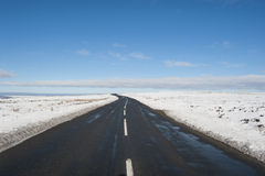 Country road through winter rural scene Royalty Free Stock Photos