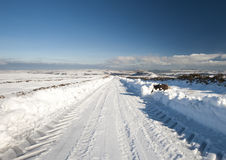 Country road through winter rural scene Royalty Free Stock Photo
