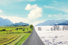 Country road through winter and spring landscape Stock Image