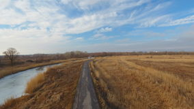Country road in winter time. Aerial view stock video footage