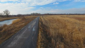 Country road in winter time. Aerial view stock footage
