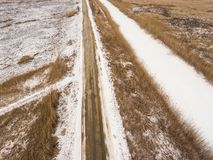 Country road in winter time. Royalty Free Stock Photo