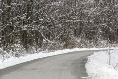 Country road in the winter time royalty free stock photography