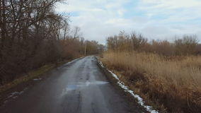Country road in winter time. Steadicam shot stock footage