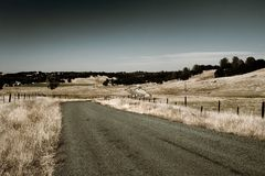 Country Roads. Winding country road made to look a bit more distressed Royalty Free Stock Photo