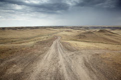 Country roads. In the desert steppe Stock Photography