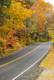 Country Roads. Country road with lots of fall foliage Royalty Free Stock Photo