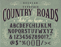 Country roads handcrafted retro typeface. Country roads, take me home. Handcrafted retro regular typeface. Vintage font design, handwritten alphabet Royalty Free Stock Image