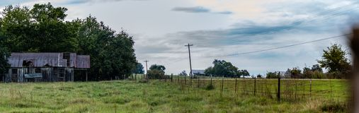 Country rural panorama with abandoned house royalty free stock photo
