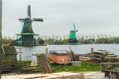 Country sawmill with lumber and old wooden boat on yard in rural Holland Royalty Free Stock Photography