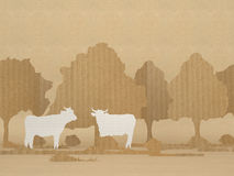 Country scene with cows and trees. Cut out of paper Royalty Free Stock Image