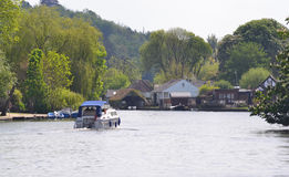 Country scene of cruiser on the river thames at Henley Royalty Free Stock Photos