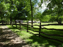Country side. Fence along dirty road at country side royalty free stock photography