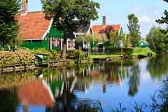 Country side houses. Reflection of the Dutch country side house at the border of a canal Stock Image