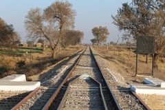 Railway line going through the country of Punjab. In the country side of Punjab, railway line of British colonial time is going through it Royalty Free Stock Photos