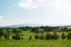 Country side slovenia. Slovenia outdoor general view tractor houses and trees landscape Royalty Free Stock Photos